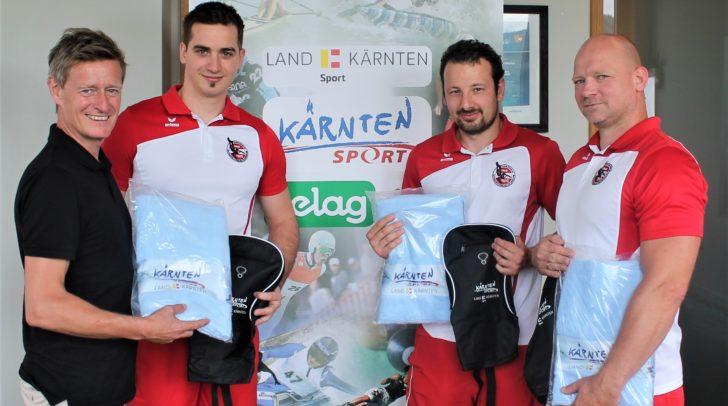 Landessportdirektor Arno Arthofer wünscht den Kärntner Unterwasser Rugby-Spielern Michael Knopper, David Schawarz und Marco Unterberger (v. li.) alles Gute für die WM in Graz.
